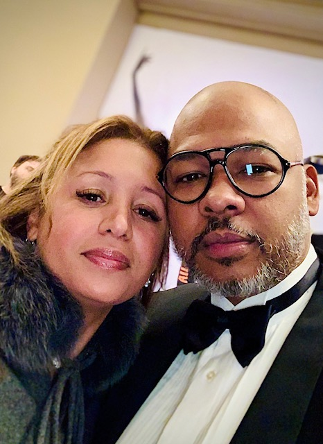 darien dash with wife wearing a tux and black glasses